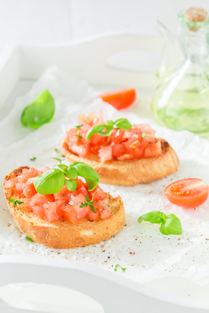 Tasty bruschetta with tomato and basil for a snack