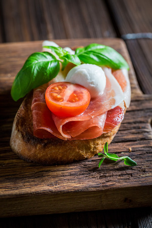 Delicious mix of bruschetta with fresh ingredients for breakfast