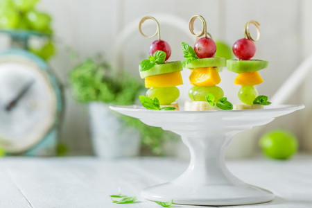 Sweet skewers with various fruits and mint for snack Reklamní fotografie - 75503045