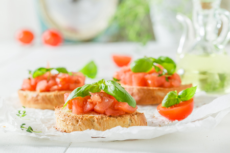 Delicious bruschetta with basil and tomato for breakfast