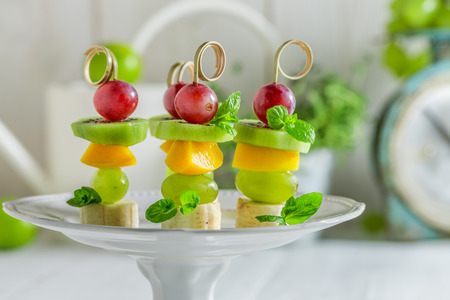 toothpick: Tasty finger food with various fruits and mint for snack