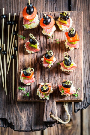 Delicious various finger food with vegetables and herbs for party