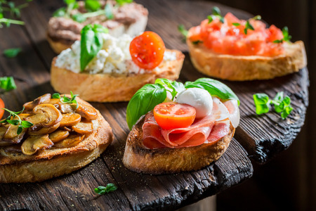 Crisp mix of bruschetta with fresh ingredients for a snack