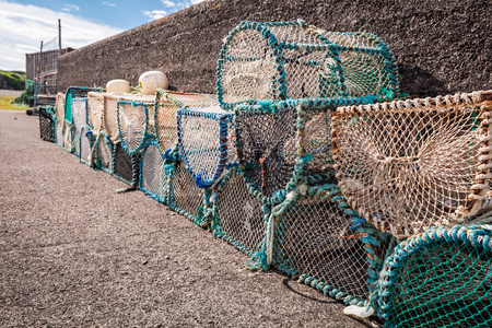 Colored fishing cage on shore in Scotland, UK