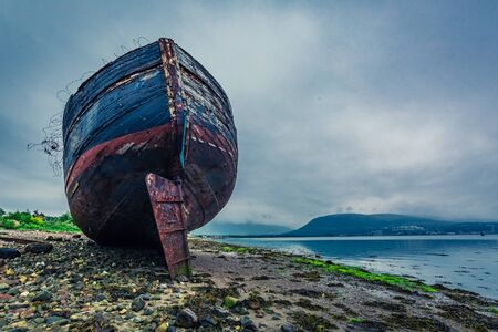 Abandoned ship wreck in Fort William in summer, Scotland