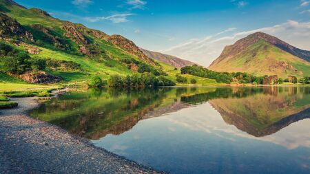 cumbria: Beautiful sunset at lake in District Lake in England