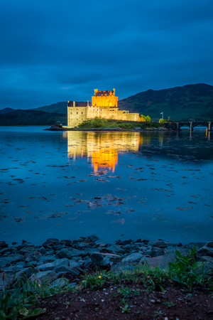 Sunset over lake at Eilean Donan Castle, Scotland, United Kingdom Editorial