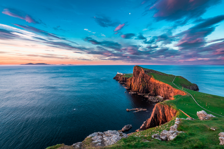 Famous dusk at the Neist point lighthouse in Scotland
