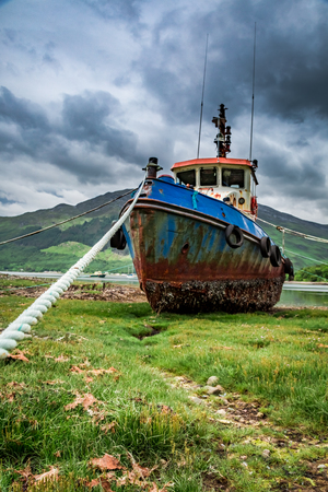 Abandoned shipwreck on shore in summer, Scotland Stock Photo