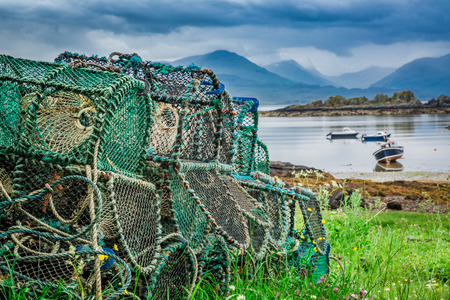 lobster boat: Old cages for lobster on shore, Scotland