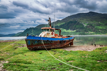Rusty shipwreck on shore in summer, Scotland, UK Reklamní fotografie