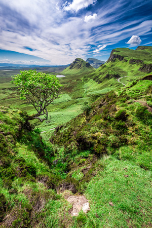 Sunny day in Quiraing to valley in Scotland, UK