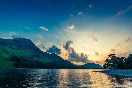 lake district england: Stunning colorful dusk at lake in District Lake, England Stock Photo