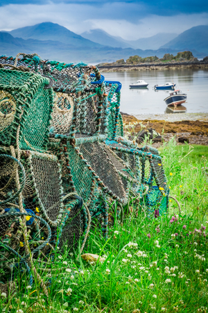 Colored cage for lobster on shore, Scotland Stock Photo