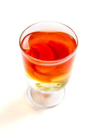 Orange jelly with fresh fruits on white background Stock Photo