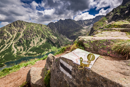Navigation in Tatra mountains with compass nad map, Poland, Europe Stock Photo