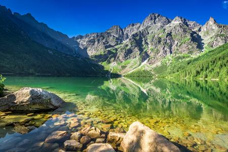 Lake in the mountains at sunrise, Poland, Europe Stock Photo