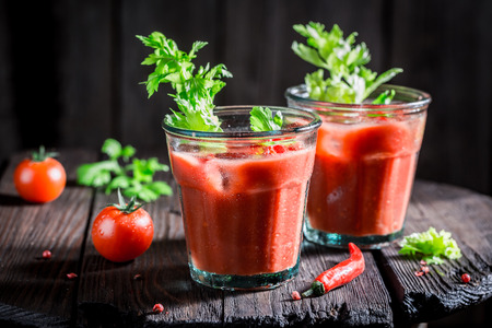 Salty bloody mary cocktail with tomatoes and ice Stock Photo