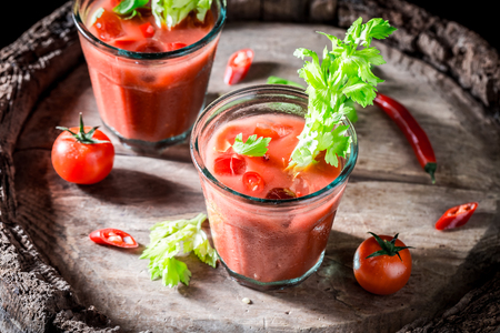 Tasty bloody mary cocktail with fresh tomatoes Stock Photo
