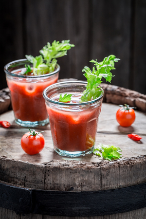 Cold bloody mary cocktail with tomatoes and celery