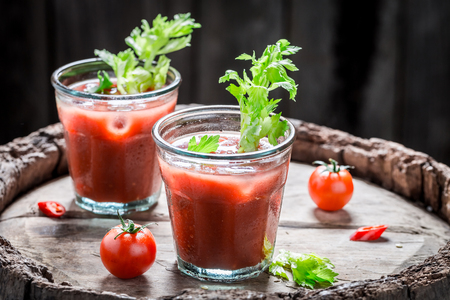 Spicy bloody mary cocktail with tomatoes and celery