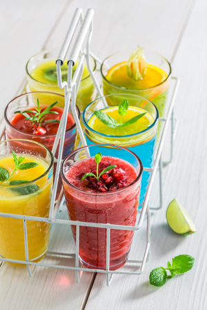 Colorfull cocktail with fresh fruits on white table