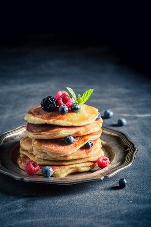 Tasty american pancakes with fresh berry fruits