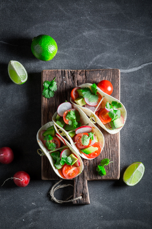 Delicious tacos with cherry tomatoes and radish