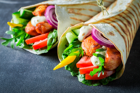 Delicious grilled tortilla with fresh vegetables and chicken