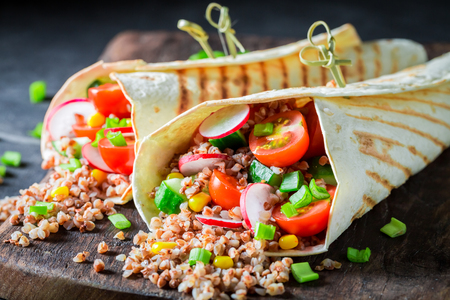 Vegetarian vegetarian tortilla with groats, chive and cherry tomatoes