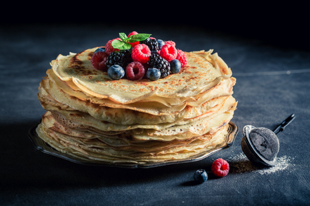 Tasty stack of pancakes with blueberries and raspberries Stock Photo