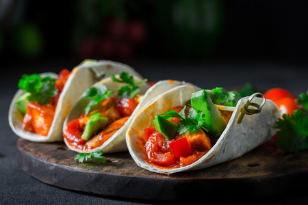 Mexican tacos with spicy sauce and fresh coriander Standard-Bild