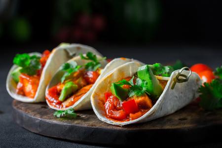 Mexican tacos with spicy sauce and fresh coriander Foto de archivo