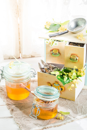 Healthy fresh linden leaves and sweet honey