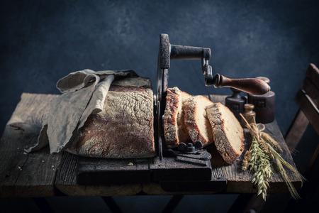 Fresh loaf of bread in dark room Stock Photo