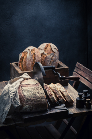 Fresh loaf of bread with flour and crumbs