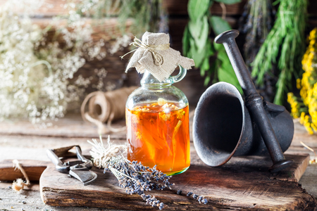 Therapeutic herbs in bottles with alcohol and honey