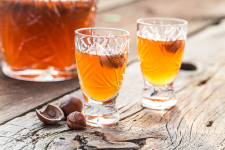 Homemade sweet liqueur with alcohol and hazelnuts