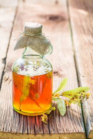 Healthy tincture in bottles as homemade cure in summer Stock Photo