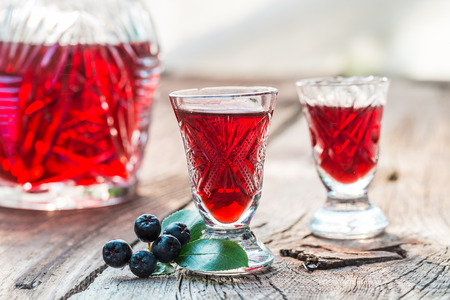 Clouseup of liqueur made of chokeberries and alcohol Stock Photo