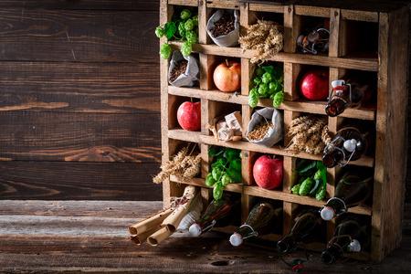 Various fresh beer ingredients in old wooden box
