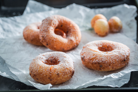Clouseup of sweet and hot golden donuts ready to eat