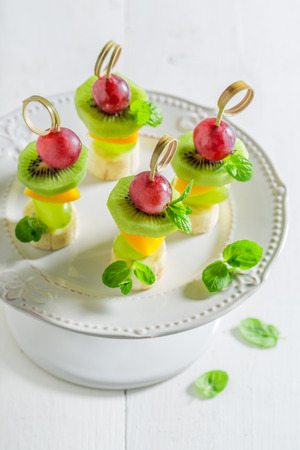 Closeup of sweet skewers with various fruits