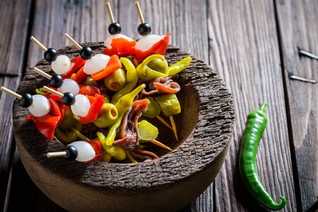 Banderillas with fresh ingredients for spanish corrida on wooden table