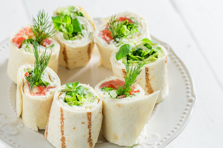 Tortilla with vegetables, cheese and herbs for a snack Stock Photo