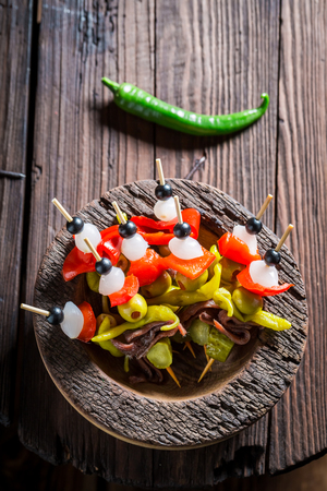 Top view of banderillas with peppers, olives and anchovies