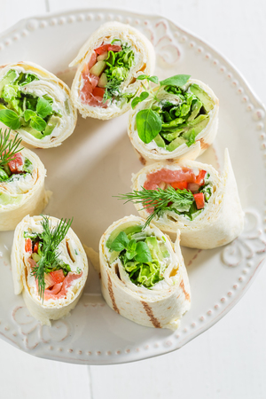 Tortilla with salmon, cheese and vegetables for a lunch Stock Photo