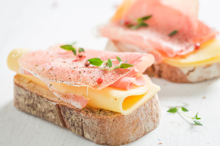 Sandwich with ham and cheese for breakfast on white table. Stock Photo