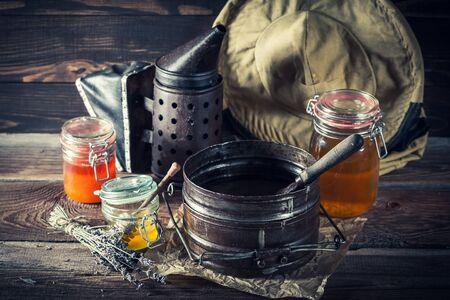 Rusty tools for beekeeping in rustic wooden workshop