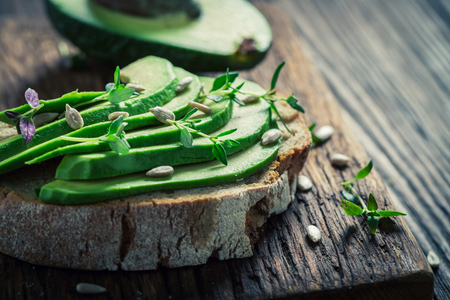 Closeup of sandwich with avocado, herbs and seeds Stock Photo - 82111591